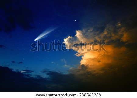 Scientific background - bright comet in dark blue sky with stars, glowing clouds - stock photo