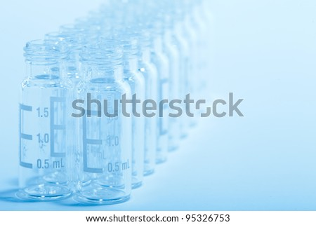 Scientific Background - Chromatography glass vials, blue tone, shallow depth of field. - Please see my portfolio for similar images - stock photo