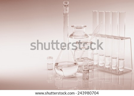 Scientific background with chemical glass, flask and tubes, sepia toning