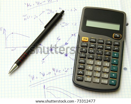 Scientific calculator and pen on notebook paper with nuclear reactions formulas - stock photo