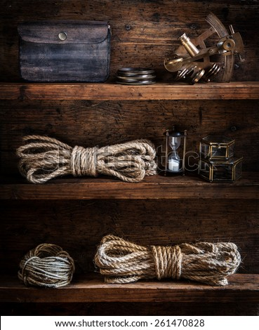 scientific expedition background. The traveller's accessories on the wooden shelf - stock photo