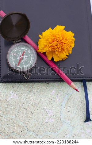 scientific expedition  on the map. compass. pencil - stock photo