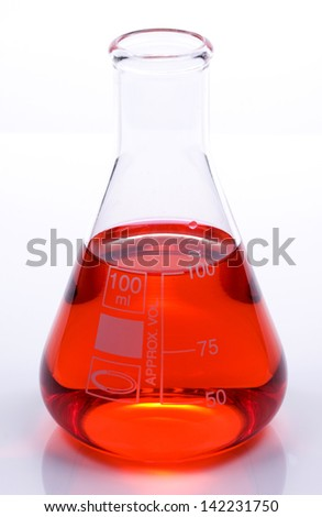 Scientific laboratory glass conical Erlenmeyer flask with red chemical liquid element suspension for a chemistry experiment in a science research lab - stock photo