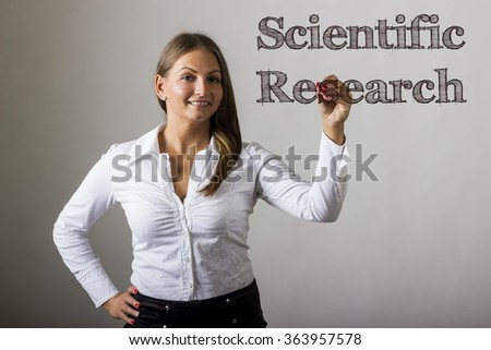 Scientific Research - Beautiful girl writing on transparent surface - horizontal image