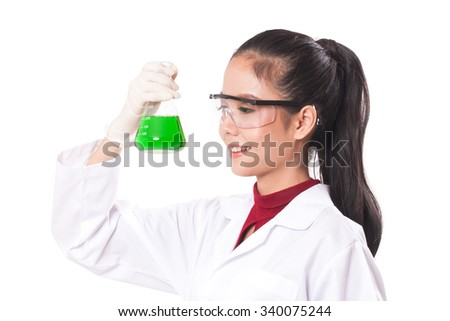 scientific researcher holding at a liquid solution on white background - stock photo