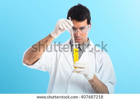 Scientist analyzing a test-tube - stock photo