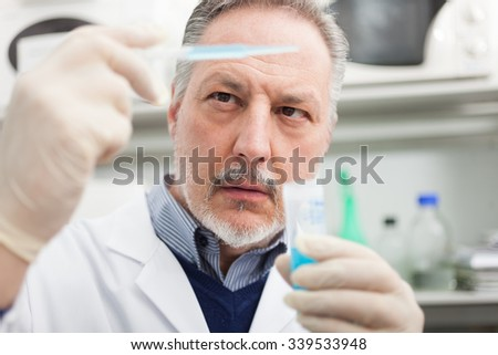 Scientist at work in his laboratory - stock photo