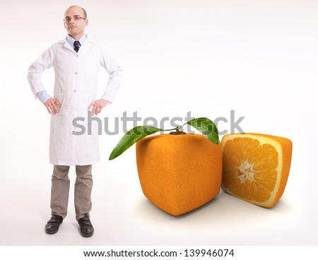 Scientist by a cubic orange  - stock photo