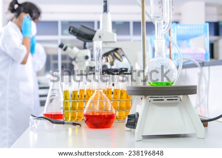 Scientist checking with florence bo-ling flask flat bottom - stock photo