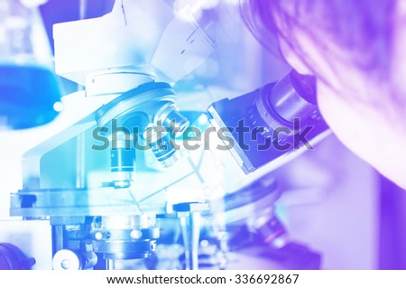 Scientist checking with microscope