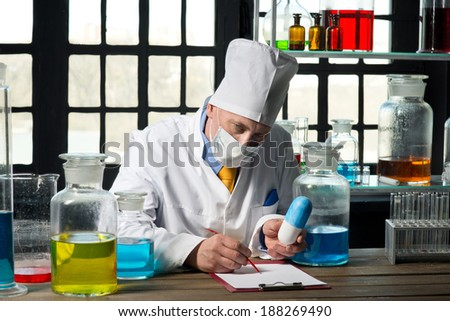 Scientist chemist at work in laboratory