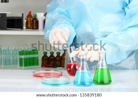 Scientist conducting research in laboratory close up - stock photo