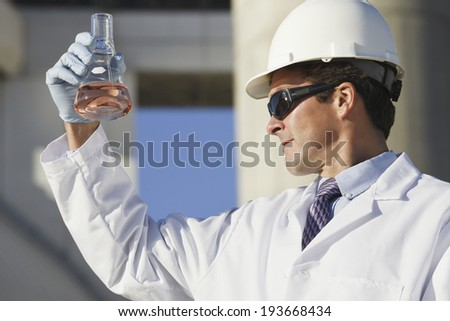 Scientist experimenting with a water sample - stock photo