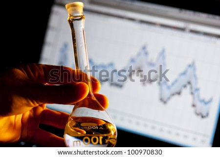 scientist holding a beaker and doing research - stock photo
