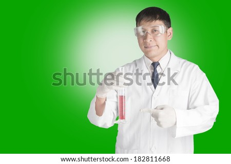 Scientist holding a test tube. - stock photo