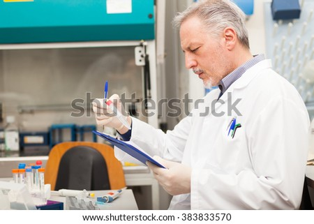 Scientist holding a test tube in his laboratory