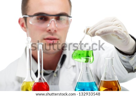 Scientist holding flask with green liquid