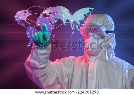 Scientist in Hazmat suit and protective gear pointing at origin of Ebola virus - stock photo
