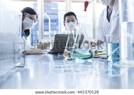 Scientist in lab. - stock photo