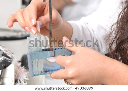 Scientist, pathologist, chemist or other lab worker takes a sample from test glass. A series of laboratory related pictures. - stock photo