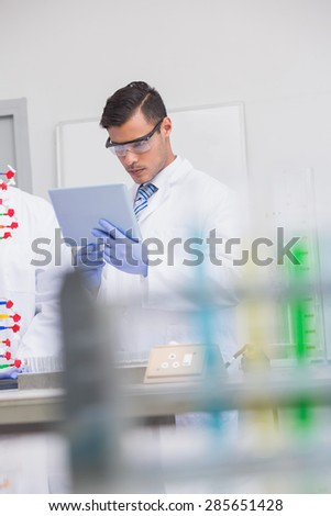 Scientist using tablet pc in the laboratory - stock photo