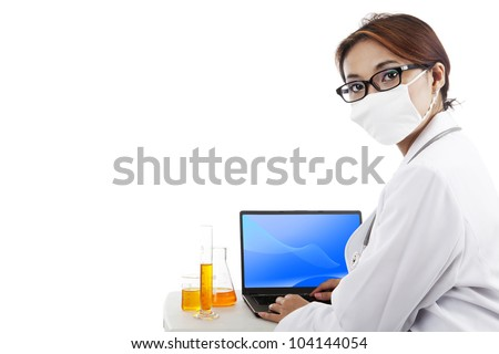 Scientist wearing mask doing research working on laptop. Isolated on white