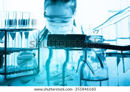 scientist with equipment and science experiments - stock photo