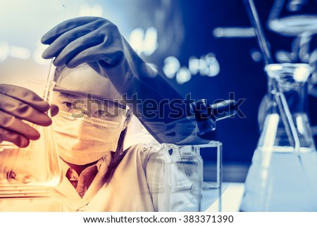scientist with equipment and science experiments,Laboratory glassware containing chemical liquid, science research - stock photo