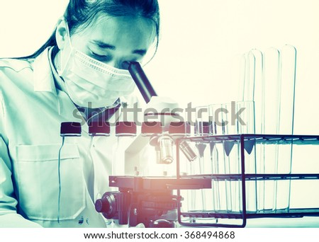scientist with equipment and science experiments ;science background