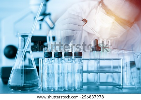scientist with equipment and science experiments ;vintage filtered style - stock photo