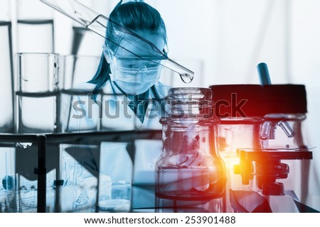 scientist with equipment and science experiments with lighting effect vintage style - stock photo