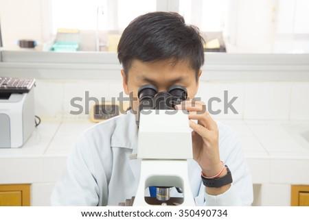 scientist with equipment Microscope. - stock photo