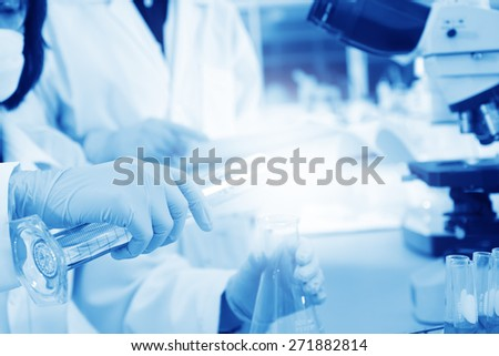 scientist working at the lab or laboratory  with fillter - stock photo