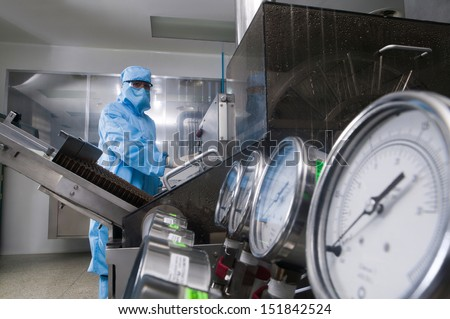 Scientist working in a pharmaceutical laboratory - stock photo