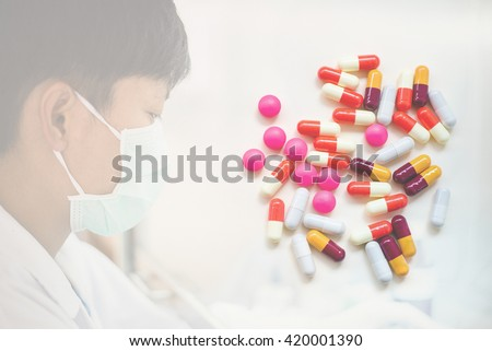 scientist working  in biological laboratory.diferent Tablets pills capsule heap mix therapy drugs doctor flu antibiotic pharmacy medicine medical - stock photo