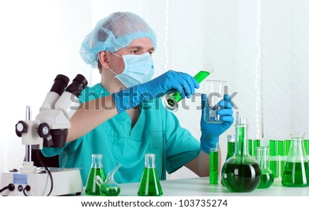 scientist working in chemistry laboratory - stock photo
