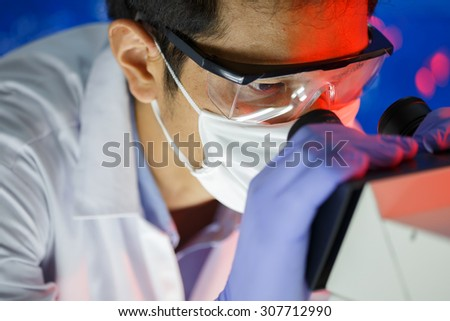 scientist working in the laboratory - stock photo