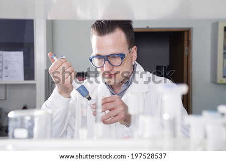 Scientist  works in chemical laboratory