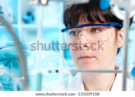 Scientist works in laboratory - stock photo