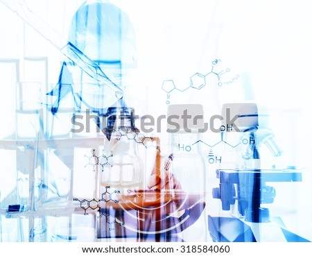 scientist writing report with equipment and science experiments with chemical equations.Double exposure style - stock photo