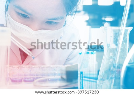 Scientists are experimenting with blending formulations for medical and scientific development - stock photo