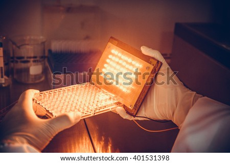 Scientists are testing the use of light LED to kill cancer cells in the lab. - stock photo