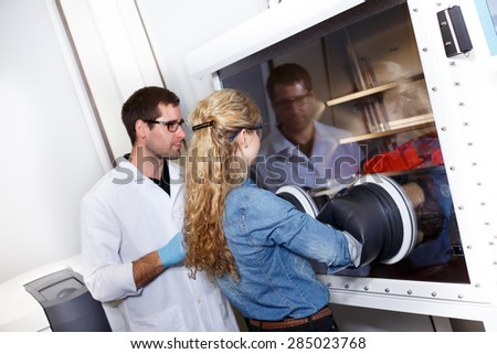 scientists conducting research in a lab environment - stock photo