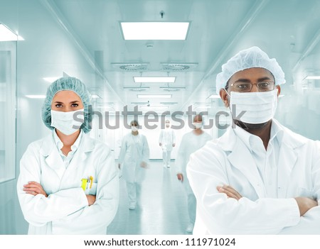Scientists doctors at modern hospital - stock photo