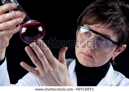 Scientists examine flask with fluid