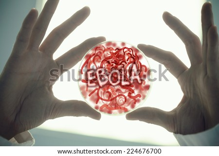 Hands holding petri dish of germs low angle view stock photo