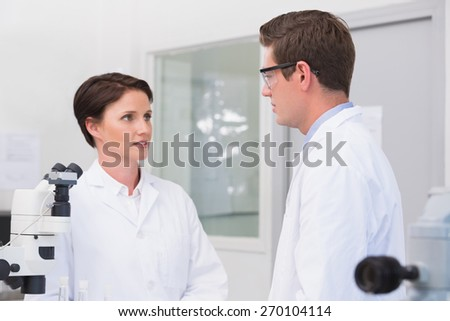 Scientists having a conversation in laboratory - stock photo