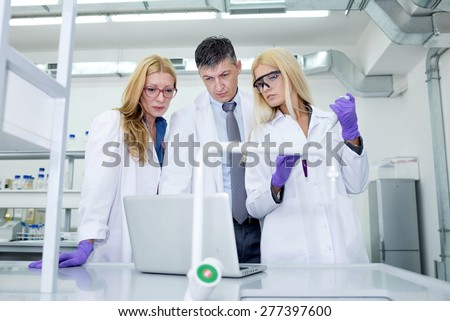 scientists in laboratory research  - stock photo
