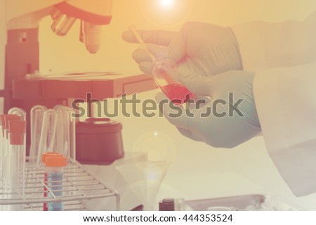 Scientists test chemical residue in the lab - stock photo