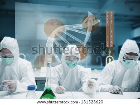 Scientists working in the lab with futuristic interface showing DNA - stock photo